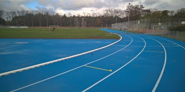 Разливна спортна тартанова настилка за лека атлетика